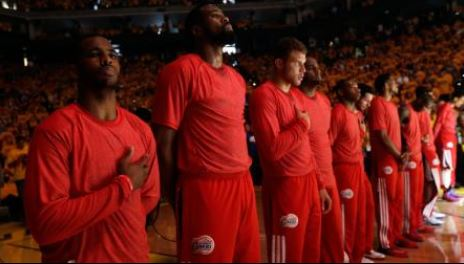 Clippers stage silent protest of Clippers owner, Donald Sterling's racist remarks at the playoff game Sunday, April 27, 2014.   PHOTO: (AP- Marcio Jose Sanchez)