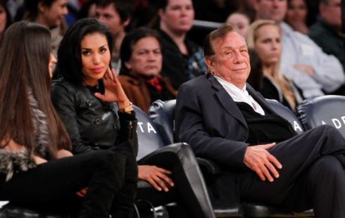 V. Stiviano pictured at a Clippers game with her then boyfriend and Clippers owner, Donald Sterling. PHOTO: Danny Moloshok (AP)